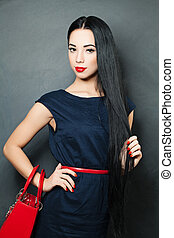 Fashion photo of young woman. Girl posing. Studio portrait