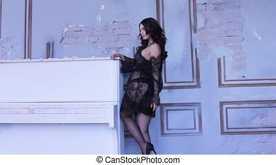 Fashion photo shoot with sexy young woman in lacy lingerie...