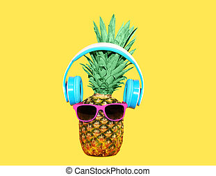 Fashion pineapple with sunglasses and headphones listens ...