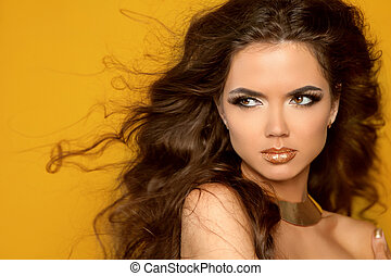 Fashion Portrait. Beauty Woman with Very Long Healthy and Shiny Curly Brown Hair.