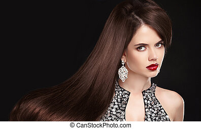 Brunette girl with long healthy wavy hair. red lips makeup