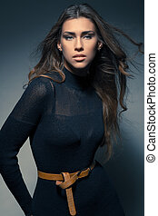 fashion portrait elegant young woman in black dress