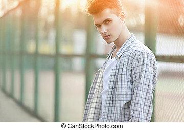 Fashion portrait handsome man in summer sunny day, deep look, st