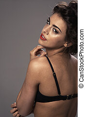 Fashion portrait of a beautiful brunette woman with shot hairstyle - studio photo