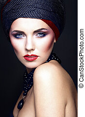 fashion portrait of a beautiful woman with blue eyes