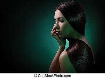 Fashion portrait of a brunette woman. Healthy Long Hair