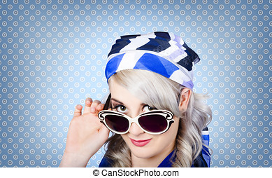 Fashion portrait of a girl in fifties sunglasses