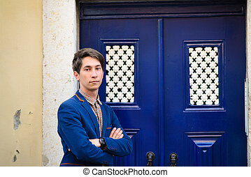 portrait of a handsome man in blue suit