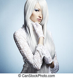 Fashion portrait of a young beautiful blonde woman. Winter Makeu