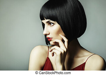 Fashion portrait of a young beautiful dark-haired woman