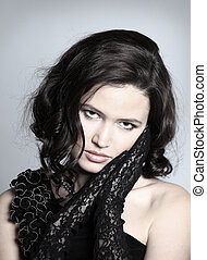 Fashion portrait of a young beautiful  woman