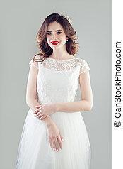 Fashion portrait of beautiful bride woman in white wedding dress