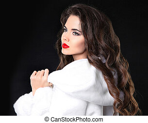 Fashion portrait of beautiful brunette girl in white fur coat
