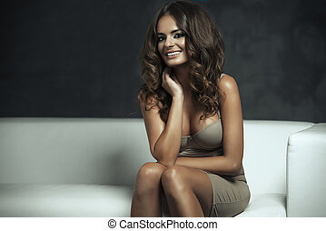 Fashion portrait of beautiful brunette woman
