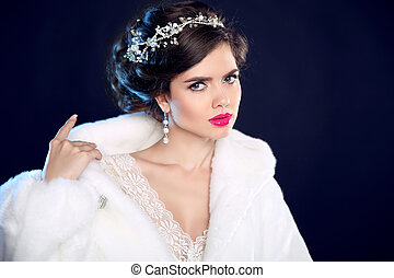 Fashion portrait of beautiful girl model in white fur coat with expensive jewelry
