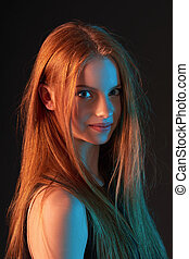 Fashion portrait of beautiful red haired girl