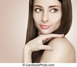 Fashion portrait of beautiful woman looking back with style hair and lips. Closeup photo of glamour female model
