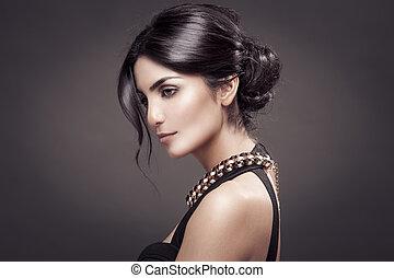 Fashion Portrait Of Beautiful Woman. Dark Background.