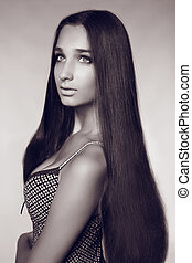 Fashion portrait of beautiful woman with long hair, black and white photo