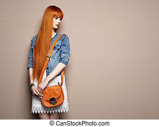 Fashion portrait of beautiful young woman with red hair