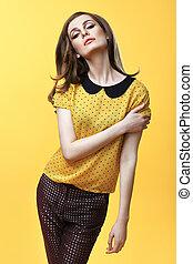 Fashion portrait of confident beautiful woman posing