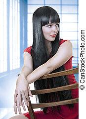 Fashion portrait of cute brunette woman.