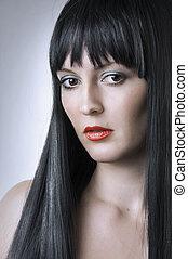 Fashion portrait of cute brunette woman