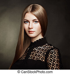 Fashion portrait of elegant woman with magnificent hair
