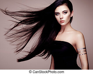 Fashion portrait of elegant woman with magnificent hair. ...