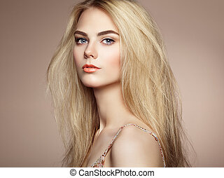 Fashion portrait of elegant woman with magnificent hair....