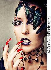 Fashion portrait of female vampire