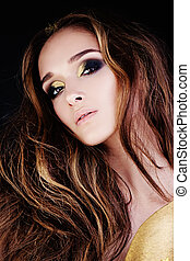 Fashion Portrait of Glamorous Woman with Golden Makeup