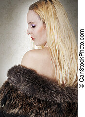 Fashion portrait of model woman in fur