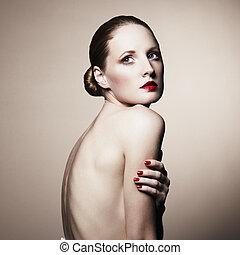 Fashion portrait of nude elegant woman