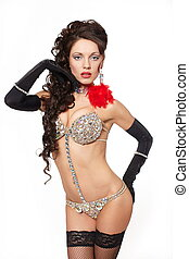 fashion portrait of pretty and sexy brunette girl in light lingerie with long curly hair and jewellery bright makeup red lips and long gloves