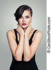 Fashion portrait of pretty model woman wearing black dress