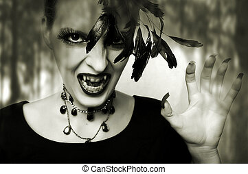 Fashion portrait of sexy female vampire