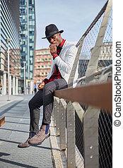 Fashion portrait of stylish young african man smoking cigarette