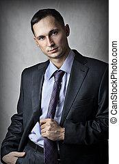 fashion portrait of successful handsome sexy man