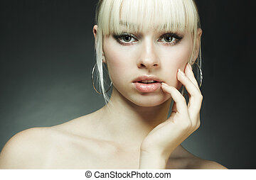Fashion portrait of the young blonde woman