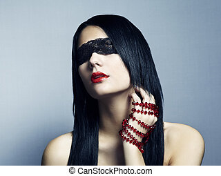 Fashion portrait of the young woman blindfold