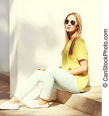 Fashion portrait of trendy pretty blonde woman in the city