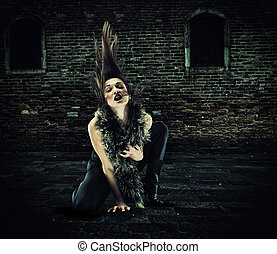 Fashion portrait of witch or night vampire woman.