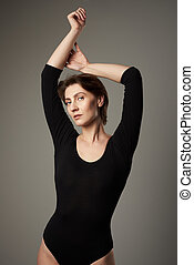 Fashion portrait of woman in black body