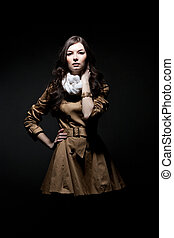 Fashion portrait of woman on dark background