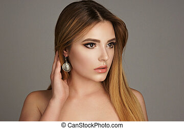 Fashion portrait of woman with jewelry