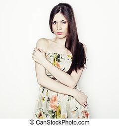 Fashion portrait of young beautiful elegant woman with dark hair