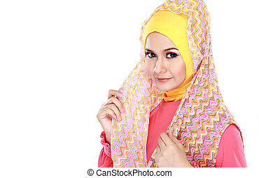 Fashion portrait of young beautiful muslim woman with pink costume wearing hijab isolated on white background