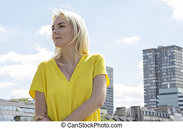 Fashion portrait of young beautiful pregnant woman in Paris.