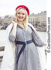 Fashion portrait of young beautiful woman in Paris.